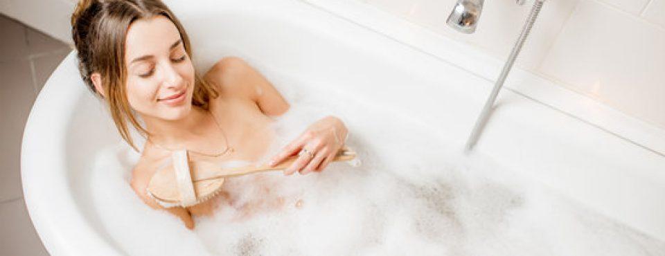 Woman bathing at the retro bathroom